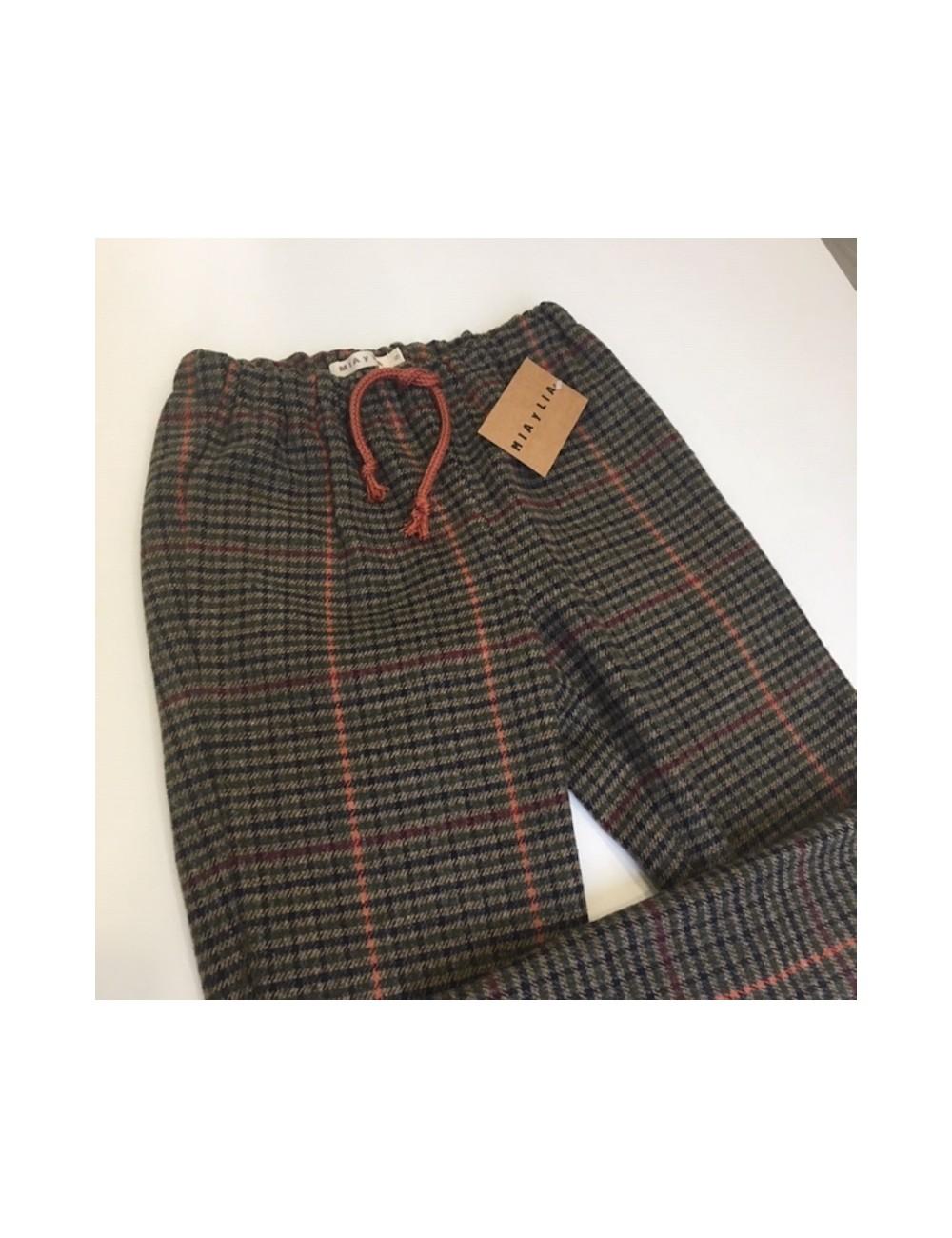Pantalon de lana cuadro tartan en colores marrones con una raya naranja y cordon en la cintura de la marca Mia y Lia