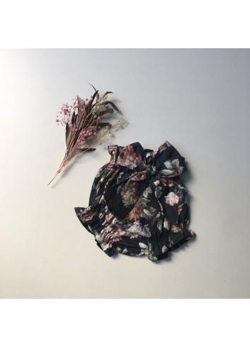 Culetin de flores azul marino con lazo de la marca Paloma de la O