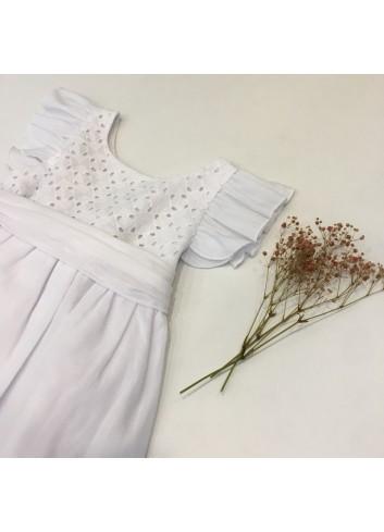 Vestido de ceremonia sin mangas con lazo en la espalda y volantes en las mangas de la marca Pilar Batanero