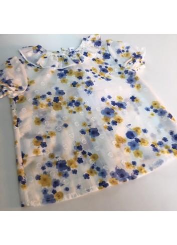 Camisa de plumetti con estampado de flores en azul y mostaza de la marca Paloma de la O