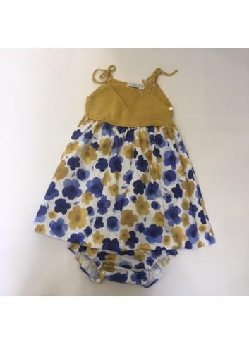 Vestido de tela de flores mostaza y azul con cuerpo de punto mostaza de la marca Paloma de la O