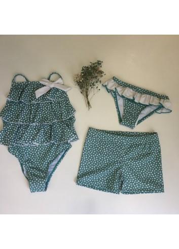 Bañador tipo braguita verde agua con topitos y volantes de la marca Pilar Batanero