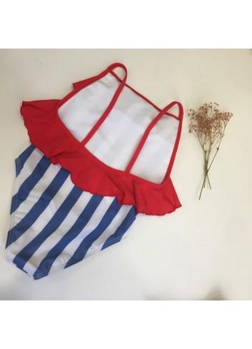 Bañador niña rayas azules con volante rojo de la marca PIlar Batanero