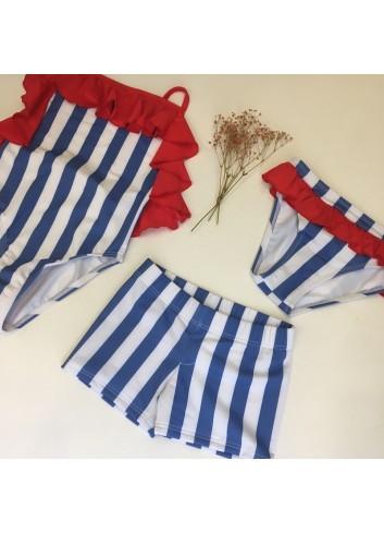 Braguita bañador niña rayas azules con volante rojo de la marca PIlar Batanero