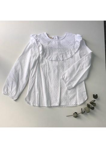 Blusa básica blanca de plumeti de niña con detalle de volante en el canesú de la marca M;ia y Lia.  Disponible también en negro.